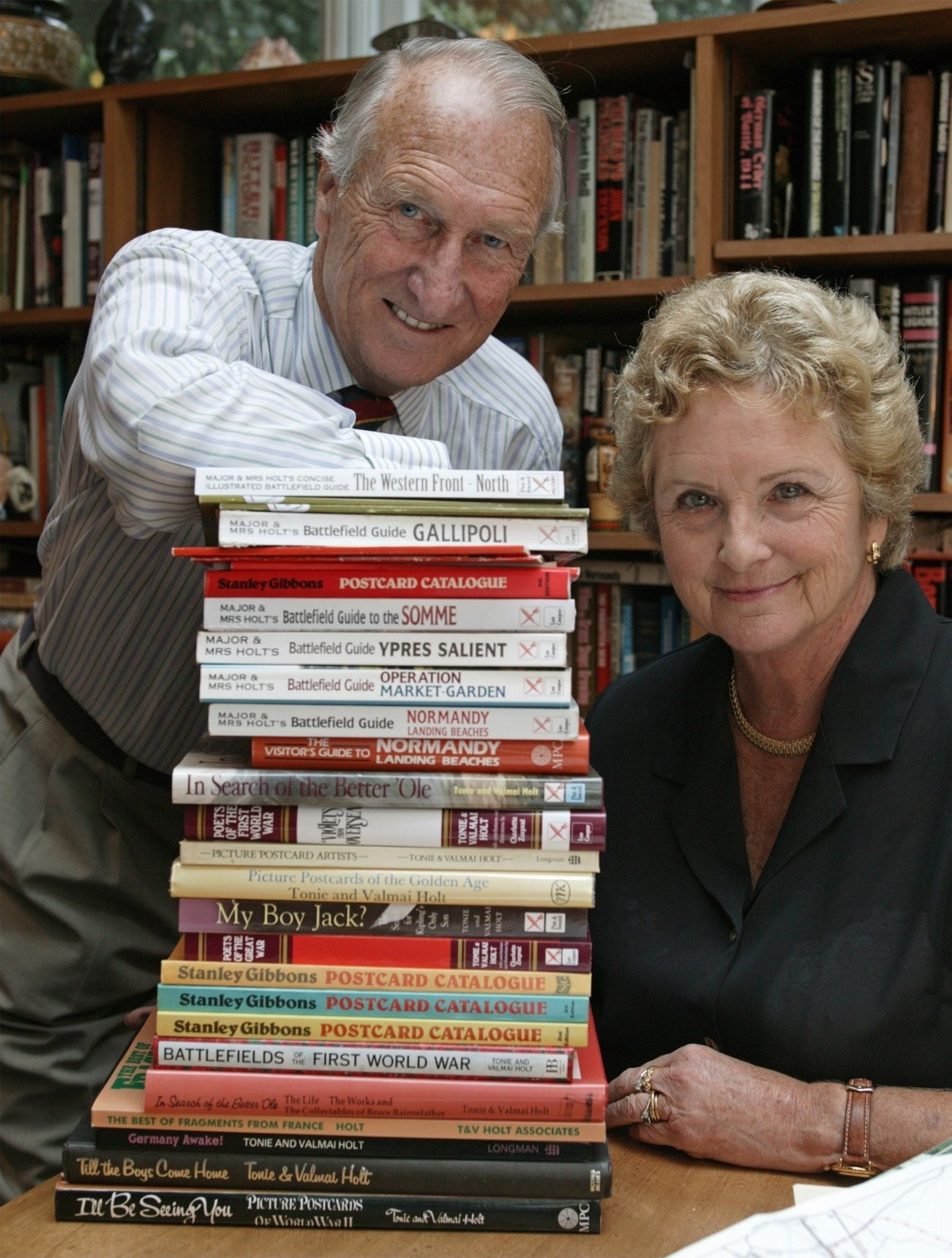 Tonie and Valmai Holt with some of their books